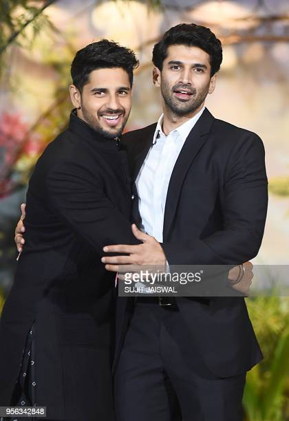 Indian Bollywood actors Sidhharth Malhotra and Aditya Roy Kapur pose for a picture during the wedding reception of actress Sonam Kapoor and...