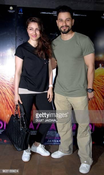 Indian Bollywood actors Soha Ali Khan and her husband Kunal Khemu attend the special screening of upcoming comedy Hindi film 'Kaalakaandi' in Mumbai...
