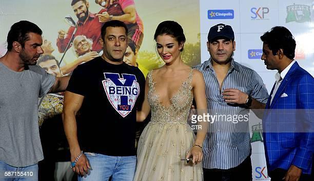 Indian Bollywood actors Sohail Khan Salman Khan Arbaaz Khan and Nawazuddin Siddiqui pose with British actress Amy Jackson during the trailer launch...