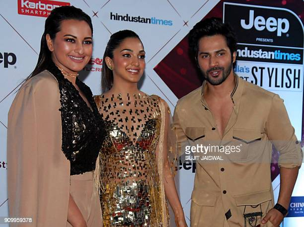 Indian Bollywood actors Sonakshi Sinha Kiara Advani and Varun Dhawan pose for a picture as they attend the HT India's Most Stylish Awards 2018 in...