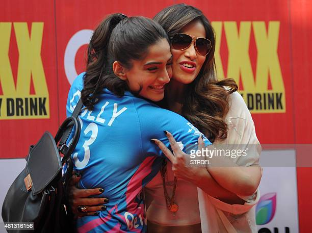 Indian Bollywood actors Sonam Kapoor and Bipasha Basu pose for a photograph during the Celebrity Cricket League season five in Mumbai on January 10...