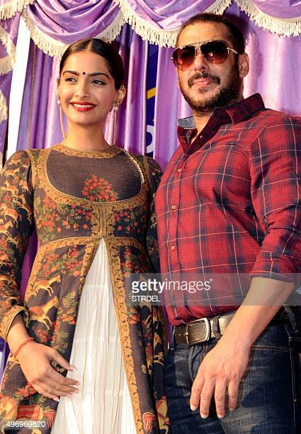 Indian Bollywood actors Sonam Kapoor and Salman Khan pose for a photograph during a promotional event for the forthcoming Hindi film 'Prem Ratan Dhan...