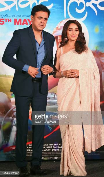 Indian Bollywood actors Sumeet Raghavan and Madhuri Dixit pose for photograph during a promotional event for the forthcoming Marathi movie 'Bucket...