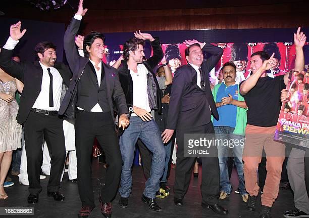 Indian Bollywood actors Sunny Deol Shahrukh Khan Hrithik Roshan Dharmendra and Aamir Khan dance during a Hindi film 'Yamla Pagla Deewana 2' music...