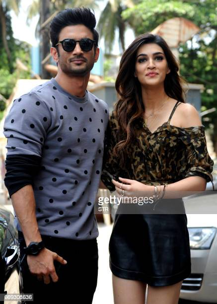 Indian Bollywood actors Sushant Singh Rajput and Kriti Sanon pose for a photograph during a promotional event for the forthcoming Hindi film 'Raabta'...