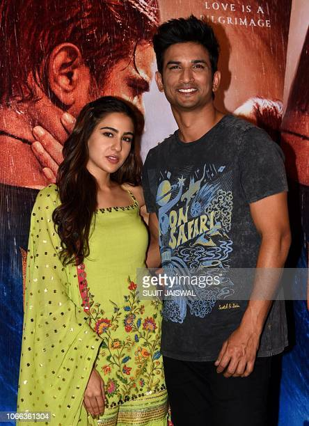 Indian Bollywood actors Sushant Singh Rajput and Sara Ali Khan pose during a promotional event for their upcoming romantic drama Hindi film...