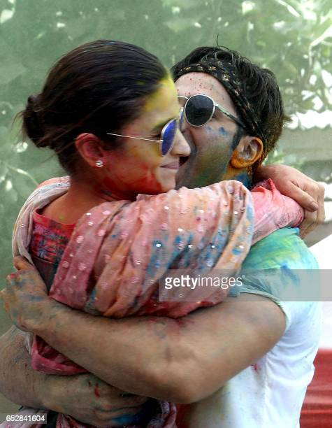 Indian Bollywood actors Varun Dhawan and Alia Bhatt take part in celebrations to mark the Hindu festival of Holi in Mumbai on March 13 2017 / AFP...