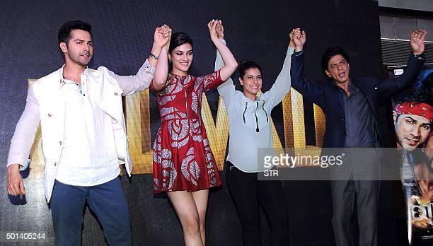 Indian Bollywood actors Varun Dhawan Kriti Sanon Kajol Devgn and Shah Rukh Khan perform during the music celebration of the upcoming Hindi film...
