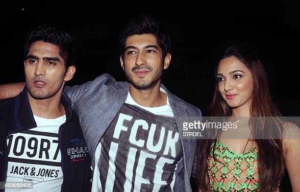 Indian Bollywood actors Vijender Singh Mohit Marwah and Kiara Advani pose for a photograph during a promotional event for the forthcoming Hindi film...