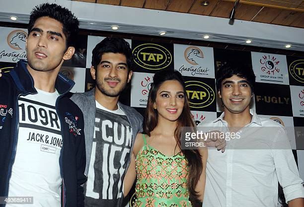 Indian Bollywood actors Vijender Singh Mohit Marwah Kiara Advani and Arfi Lamba pose for a photograph during a promotional event for the forthcoming...