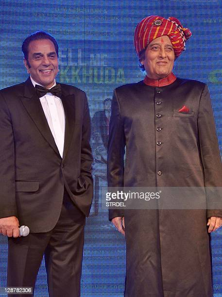"""Indian Bollywood actors Vinod Khanna and Dharmendra pose during a function promoting the forthcoming Hindi film """"Tell Me O Khuda"""" in Mumbai late..."""