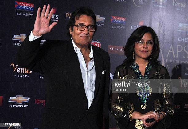 Indian Bollywood actors Vinod Khanna and Zeenat Aman pose as they arrive for the '7th Apsara Awards' ceremony in Mumbai on January 25 2012 AFP...