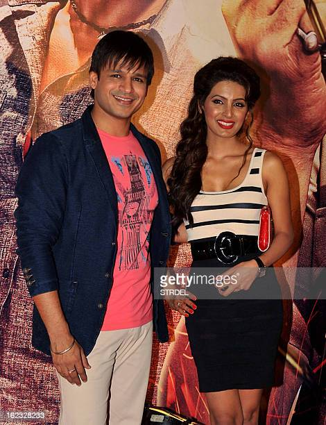 Indian Bollywood actors Vivek Oberoi and Geeta Basra pose for a photo at the premier of the Hindi film 'Zila Ghaziabad' in Mumbai on February 21 2013...