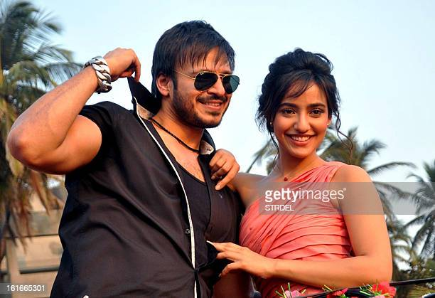 Indian Bollywood actors Vivek Oberoi and Neha Sharma pose for photos during the promotion of upcoming Hindi film Jayantabhai Ki LUV Story in Mumbai...