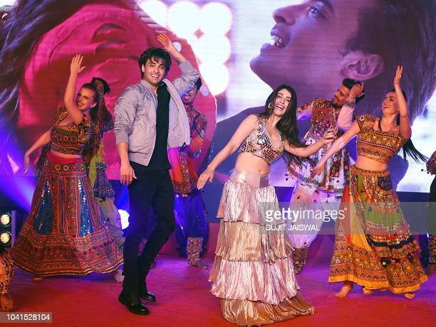 Indian Bollywood actors Warina Hussain and Aayush Sharma dance during the promotion of the upcoming musical romantic drama Hindi film 'Loveyatri' in...
