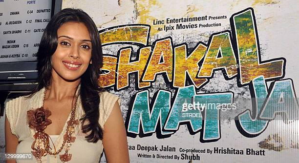 Indian Bollywood actress Aamna Sharif poses during a promotional event for the forthcoming Hindi film 'Shakal Pe Mat Ja' in Mumbai on October 22 2011...