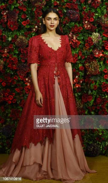 Indian Bollywood actress Aditi Rao Hydari poses for a picture during the wedding reception party of actors Ranveer Singh and Deepika Padukone in...