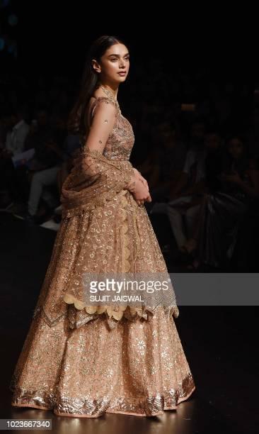 Indian Bollywood actress Aditi Rao Hydari showcases a creation by designer Jayanti Reddy at the Lakmé Fashion Week Winter/Festive 2018 in Mumbai on...
