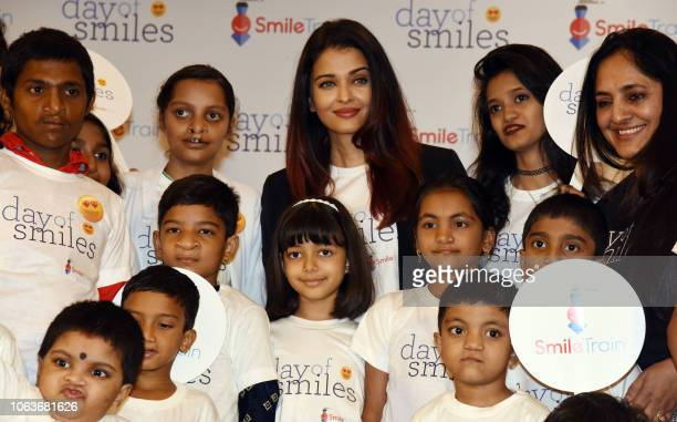 Indian Bollywood actress Aishwarya Rai Bachchan and her daughter Aaradhya Bachchan pose with children during a birthday event with NGO Smile Train...