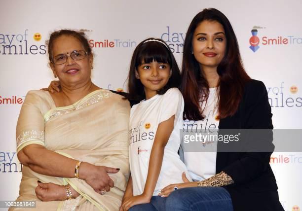 Indian Bollywood actress Aishwarya Rai Bachchan daughter Aaradhya Bachchan and mother Vrunda Rai pose during a birthday event with NGO Smile Train...