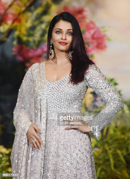 Indian Bollywood actress Aishwarya Rai Bachchan poses for a picture during the wedding reception of actress Sonam Kapoor and businessman Anand Ahuja...