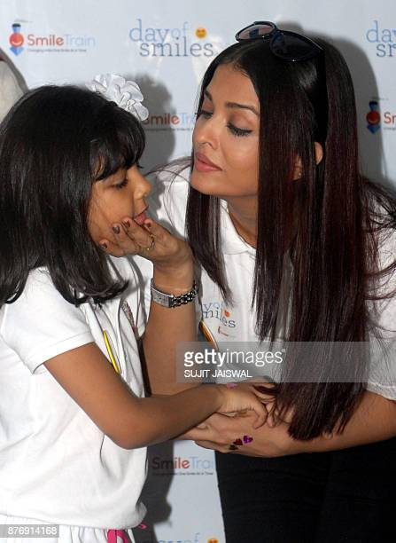 Indian Bollywood actress Aishwarya Rai Bachchan poses for a photograph with her daughter Aaradhya during a promotional event in Mumbai on November 20...