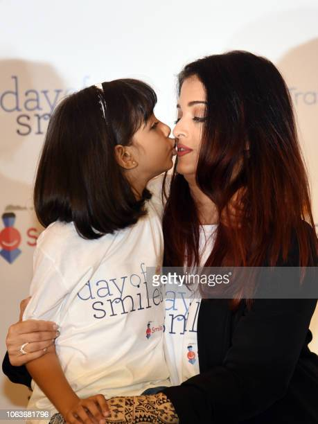 Indian Bollywood actress Aishwarya Rai Bachchan poses with her daughter Aaradhya Bachchan during a birthday event with NGO Smile Train India in...