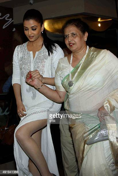 Indian Bollywood actress Aishwarya Rai Bachchan with her mother attends the special screening of the Hindi film 'Jazbaa' directed by Sanjay Gupta in...