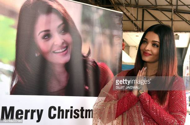 Indian Bollywood actress Aishwarya Rai gestures as she participates in a Christmas event origanized by Cancer Patients Aid Association in Mumbai on...