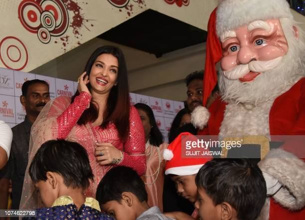 Indian Bollywood actress Aishwarya Rai looks on as she participates in a Christmas event origanized by Cancer Patients Aid Association in Mumbai on...