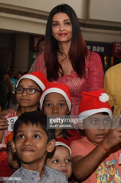 Indian Bollywood actress Aishwarya Rai poses for a picture as she participates in a Christmas event origanized by Cancer Patients Aid Association in...