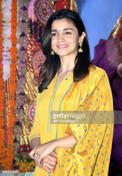 Indian Bollywood actress Alia Bhatt attends the celebration of North Bombay Sarbojanin Durga Puja Samiti in Mumbai on September 29 2017 / AFP PHOTO /...