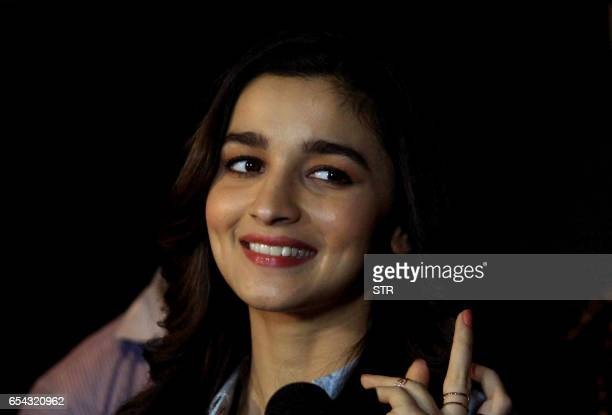 Indian Bollywood actress Alia Bhatt poses during a special screening of the Hollywood film Beauty and the Beast in Mumbai late March 16 2017 / AFP...