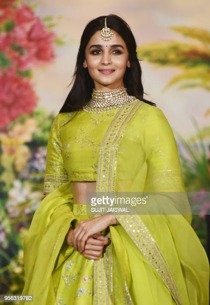 Indian Bollywood actress Alia Bhatt poses for a picture during the wedding reception of actress Sonam Kapoor and businessman Anand Ahuja in Mumbai...