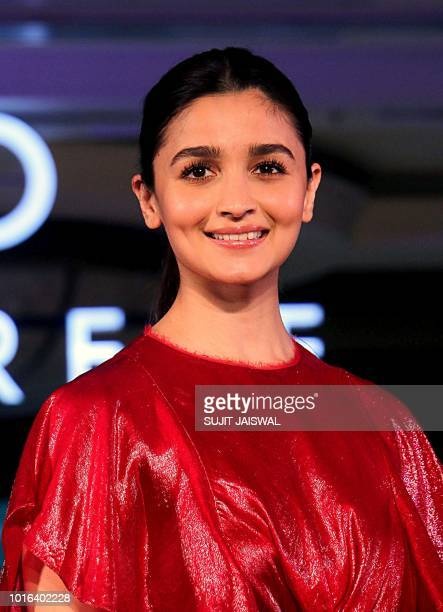Indian Bollywood actress Alia Bhatt presents a creation during the Caprese collection launch in Mumbai late on August 13 2018