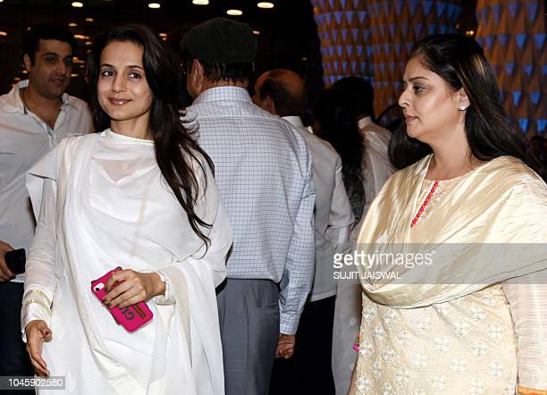 Indian Bollywood actress Ameesha Patel and Nagma attend a prayer meet for the late Krishna Raj Kapoor wife of late actor Raj Kapoor in Mumbai on...