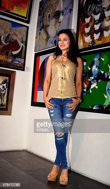 Indian Bollywood actress Ameesha Patel poses during the inauguration of the exhibition Colors of Life Crafted Change organised by The Cancer Patients...