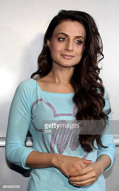 Indian Bollywood actress Ameesha Patel poses for a photograph during filming for the forthcoming Hindi film 'Bhaiyyaji Superhitt' in Mumbai on July...