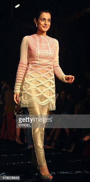 Indian Bollywood actress Ameesha Patel poses for a photograph on the first day of the Lakme Fashion Week Summer/Resort 2014 in Mumbai on late March...