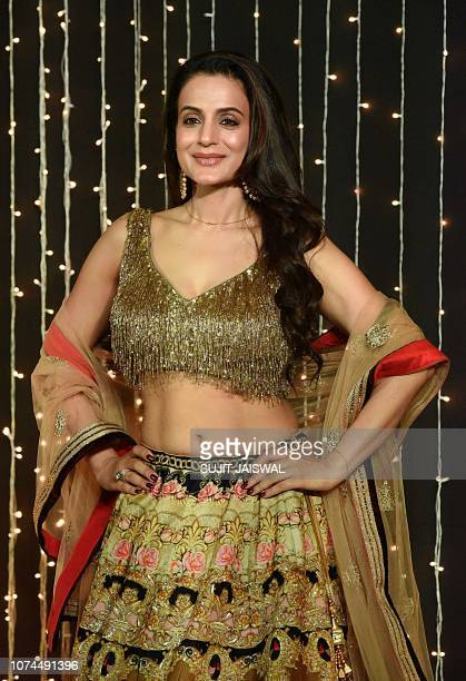 Indian Bollywood actress Ameesha Patel poses for a picture during the wedding reception party of actress Priyanka Chopra and US musician Nick Jonas...