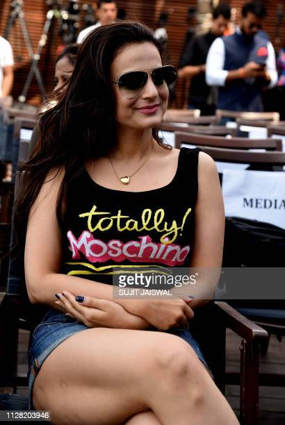 Indian Bollywood actress Ameesha Patel takes part in a blessing event for the start of the upcoming film 'Smile Please' in Mumbai on March 1 2019