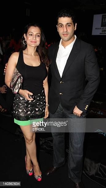 Indian Bollywood actress Amisha Patel and her boyfriend Kunal Goomer attend the first day of Lakme Fashion Week summer resort 2012 in Mumbai on March...