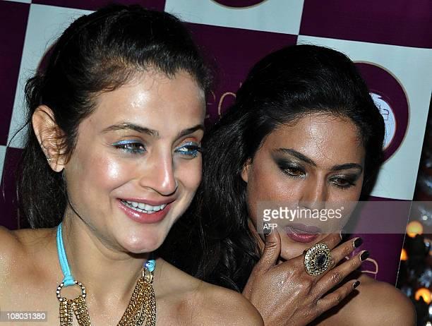 Indian Bollywood actress Amisha Patel and Pakistani actress Veena Malik attend Ashmit Patel's birthday party in Mumbai on January 13 2011 AFP...