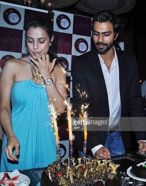 Indian Bollywood actress Amisha Patel licks her finger as she attends her brother's Indian bollywood actor Ashmit Patel 33th birthday party in Mumbai...