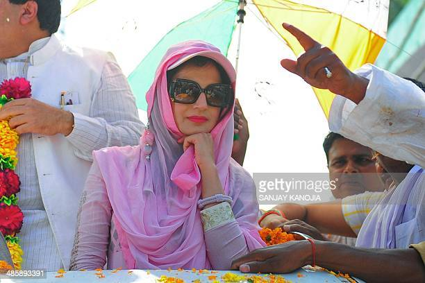 Indian Bollywood actress Amisha Patel participates in an election roadshow for Congress candidate for Allahabad parliamentary constituency Nand Gopal...