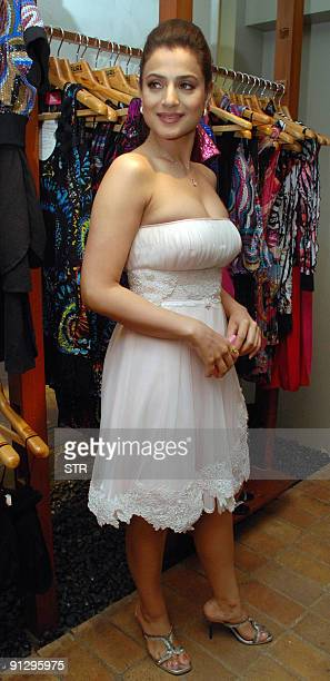 Indian Bollywood actress Amisha Patel poses with an outfit designed by Nishka Lulla at a store in Mumbai on October 1 2009 AFP PHOTO/STR