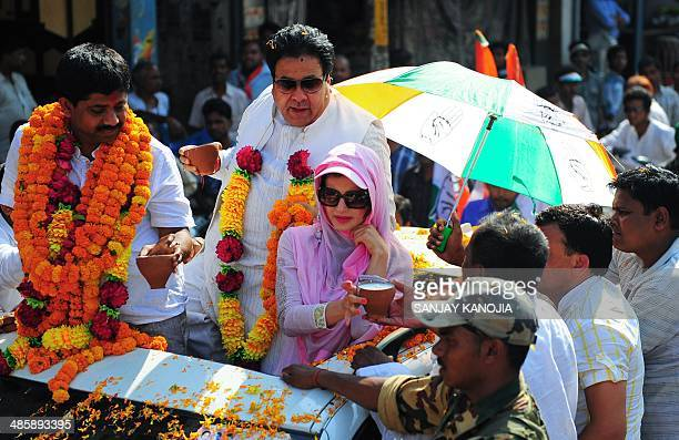 Indian Bollywood actress Amisha Patel receives sweets from a supporter during an election roadshow for Congress candidate for Allahabad parliamentary...