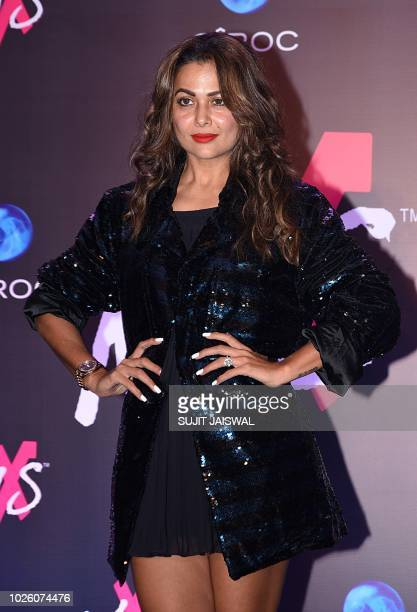 Indian Bollywood actress Amrita Arora poses during the store launch of the fashion label MXS in Mumbai on September 1 2018