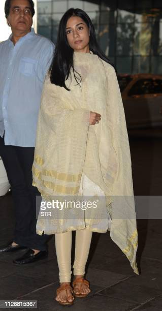 Indian Bollywood actress Amrita Rao attends a prayer event in homage to film director Rajkumar Barjatya deceased on February 21 in Mumbai on February...