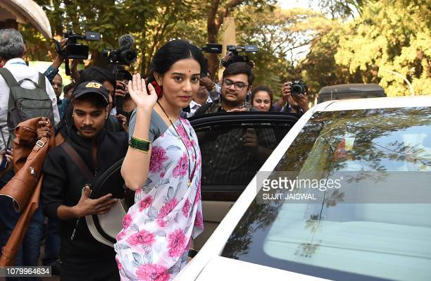 Indian Bollywood actress Amrita Rao gestures during the promotion of the upcoming bilingual biographical film 'Thackeray' in Mumbai on January 10 2019